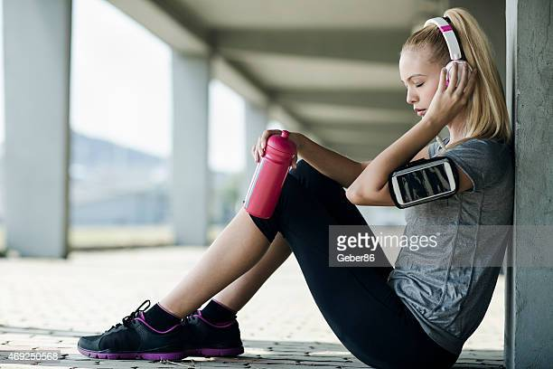 Photo of a young woman resting after exercise