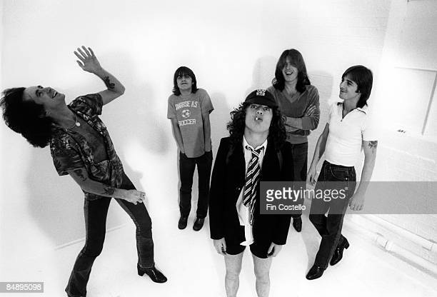 CAMDEN Photo of AC DC and AC/DC and Angus YOUNG and Bon SCOTT and Malcolm YOUNG and Phil RUDD and Cliff WILLIAMS Posed studio group portrait LR Bon...