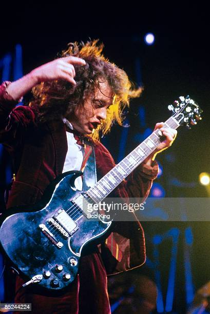 CENTRE Photo of AC DC and Angus YOUNG and AC/DC Angus Young performing live onstage playing Gibson SG guitar