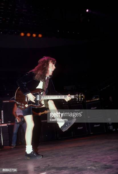 Photo of AC DC and Angus YOUNG and AC/DC Angus Young performing live onstage playing Gibson SG guitar