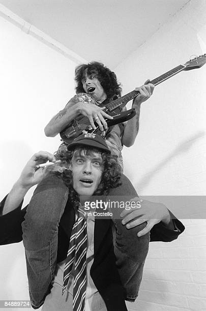 CAMDEN Photo of AC DC and Bon SCOTT and AC/DC and Angus YOUNG Bon Scott sitting on Angus Young's shoulders