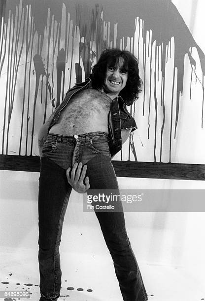 CAMDEN Photo of AC DC and Bon SCOTT and AC/DC Posed studio portrait of Bon Scott crotch grabbing