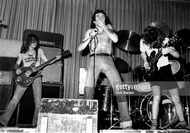 ROOMS Photo of AC DC and Bon SCOTT and Malcolm YOUNG and Angus YOUNG and AC/DC Malcolm Young Bon Scott Angus Young performing live onstage on first...