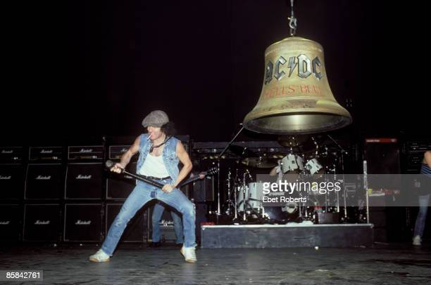 Photo of AC DC and Brian JOHNSON and AC/DC Brian Johnson performing live onstage with giant 'Hell's Bells' bell behind