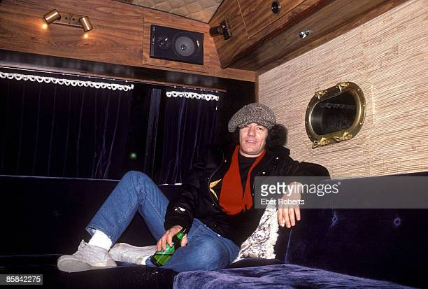 Photo of AC DC and Brian JOHNSON and AC/DC Brian Johnson posed on tourbus holding beer