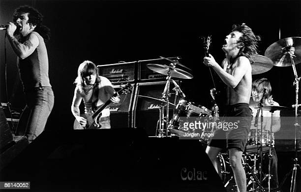 Photo of AC DC and Malcolm YOUNG and Bon SCOTT and Angus YOUNG and AC/DC and Phil RUDD Bon Scott Malcolm Young Angus Young Phil Rudd performing live...