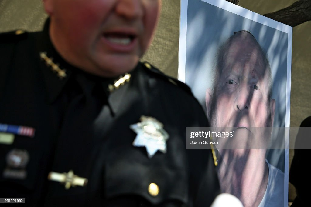 A photo of accused rapist and killer Joseph James DeAngelo is displayed during a news conference on April 24, 2018 in Sacramento, California. Sacramento district attorney Anne Marie Schubert was joined by law enforcement officials from across California to announce the arrest of 72 year-old Joseph James DeAngelo who is believed to be the the East Area Rapist, also known as the Golden State Killer, who killed at least 12, raped over 45 people and burglarized hundreds of homes throughout California in the 1970s and 1980s.