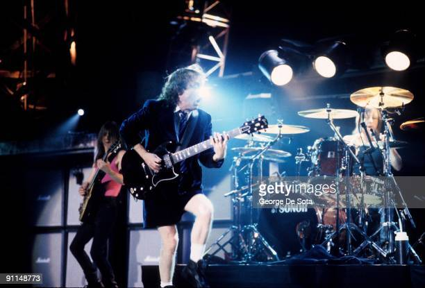 Photo of AC/DC and AC DC and Phil RUDD and Malcolm YOUNG and Angus YOUNG LR Malcolm Young Angus Young and Phil Rudd performing on stage Photo by...