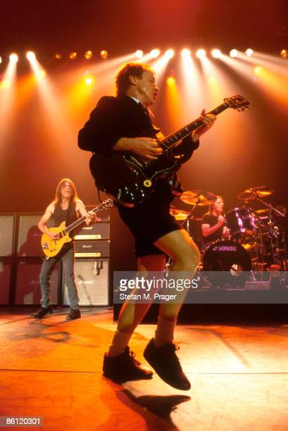 CLUB Photo of AC/DC and Angus YOUNG and Phil RUDD and Malcolm YOUNG and AC DC Malcolm Young Angus Young and Phil Rudd performing live onstage
