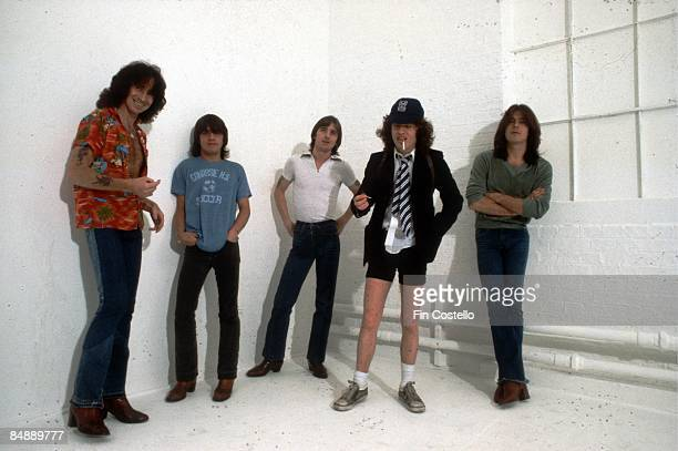 CAMDEN Photo of AC/DC and Cliff WILLIAMS and Bon SCOTT and Malcolm YOUNG and Angus YOUNG and Phil RUDD and AC DC Posed studio group portrait of LR...