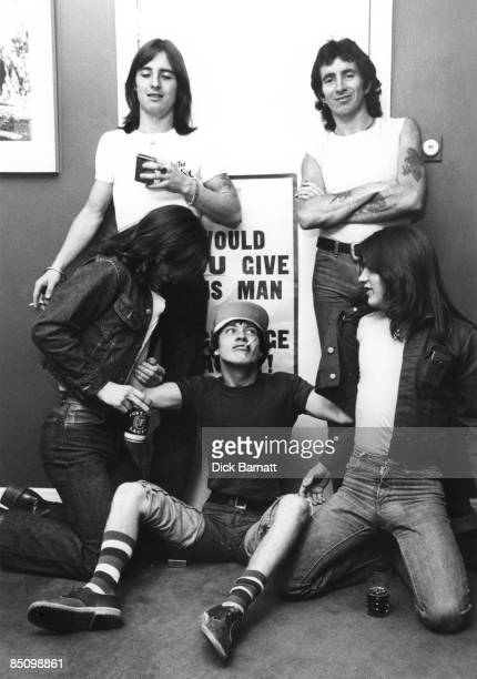 Photo of AC/DC and Phil RUDD and Bon SCOTT and Malcolm YOUNG and Angus YOUNG and Mark EVANS Group backstage Back Phil Rudd and Bon ScottFront Malcolm...