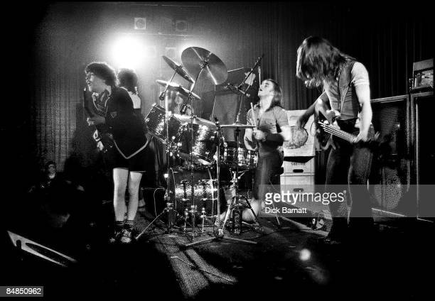 ROOMS Photo of AC/DC Angus Young Phil Rudd Mark Evans performing live onstage on first UK tour