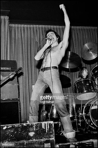ROOMS Photo of AC/DC Bon Scott and Phil Rudd performing live onstage on first UK tour