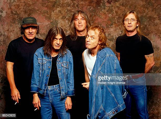 Photo of AC/DC LR Brian Johnson Malcolm Young Cliff Williams Angus Young Phil Rudd posed studio group shot at Rockwalk Induction