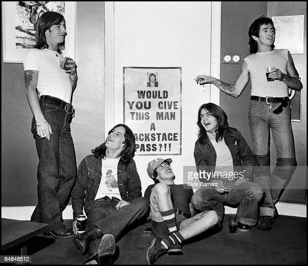Photo of AC/DC LR Phil Rudd Mark Evans Angus Young Malcolm Young Bon Scott posed group shot at press reception in WEA offices