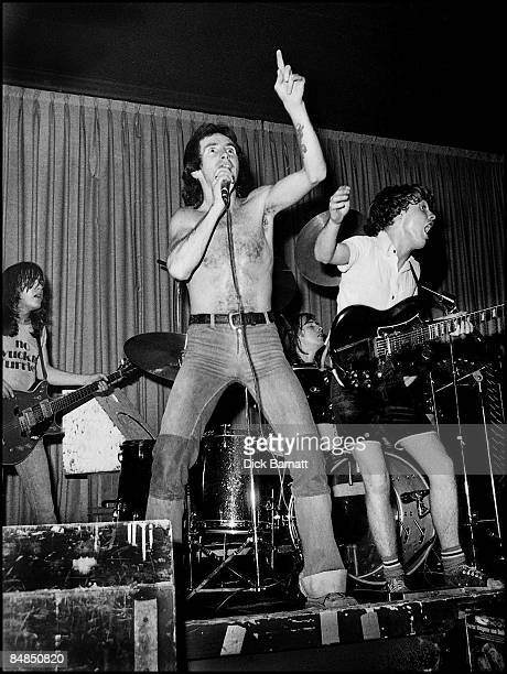 ROOMS Photo of AC/DC Malcolm Young Bon Scott Angus Young performing live onstage on first UK tour