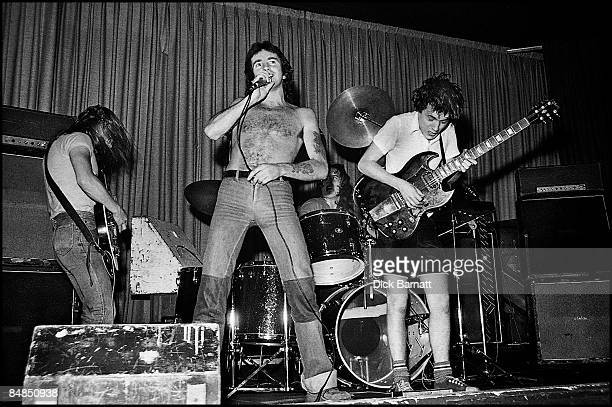 ROOMS Photo of AC/DC Malcolm Young Bon Scott Phil Rudd Angus Young performing live onstage on first UK tour with Marshall stack amplifiers behind