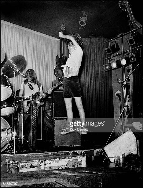 ROOMS Photo of AC/DC Nashville Rooms 1976 Mark Evans and Angus Young performing live onstage on first UK tour