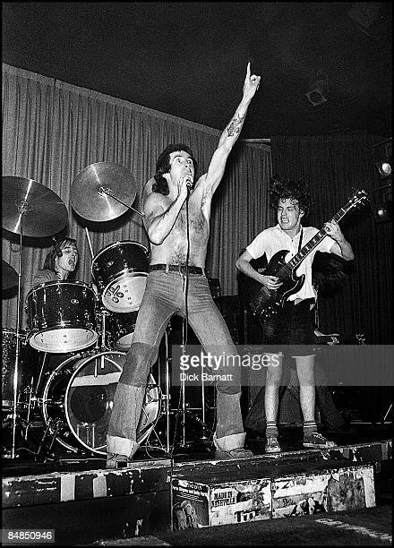 ROOMS Photo of AC/DC Phil Rudd Bon Scott Angus Young performing live onstage on first UK tour