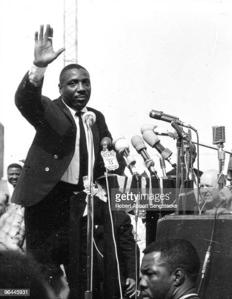 Photo of activist Dick Gregory waving to the crowd assembled to hear Dr Martin Luther King Jr at Wrigley Field in Los Angeles May 1963 This was Dr...