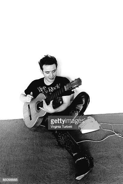 Photo of Adam ANT and ADAM THE ANTS Portrait of Adam Ant sitting playing acoustic guitar