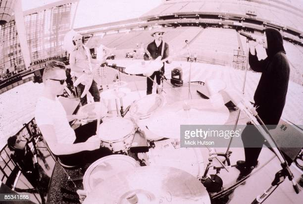 Photo of Adam CLAYTON and U2 and BONO and Larry MULLEN Jnr and THE EDGE LR Larry Mullen Jnr Adam Clayton The Edge Bono playing in soundcheck on Pop...