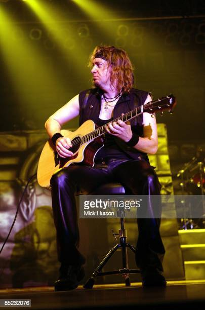 FORUM Photo of Adrian SMITH and IRON MAIDEN Adrian Smith performing live onstage playing Taylor acoustic guitar