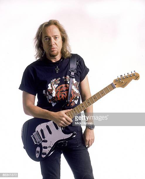 Photo of Adrian SMITH and IRON MAIDEN Adrian Smith posed studio with Fender Stratocaster guitar