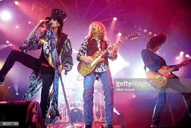 ARENA Photo of AEROSMITH and Joe PERRY and Brad WHITFORD and Steven TYLER LR Steven Tyler Brad Whitford Joe Perry performing live onstage
