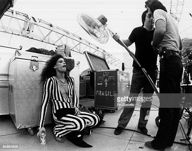 Photo of AEROSMITH and Steven TYLER, Steven Tyler backstage at the RFK Stadium, being cooled by large fan