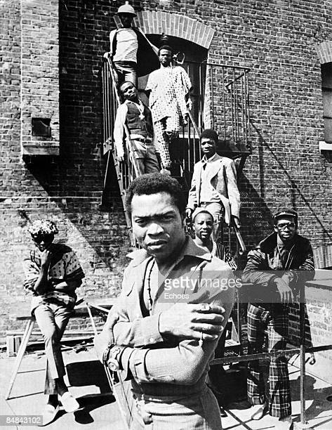 Photo of AFRICA 70 and Fela KUTI Posed portrait of Fela Kuti with his group Africa 70 behind him on fire escape stairs