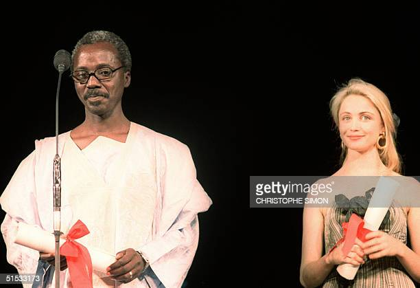 Photo of African film director Souleymane Cisse and French actress Emmanuelle Beart taken 19 May 1987 after they were awarded at the Cannes...