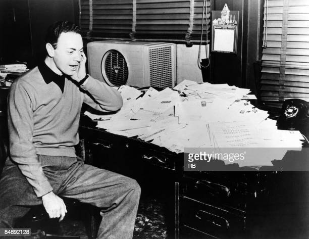 Photo of Alan FREED; Alan Freed 'Moondog' in his office
