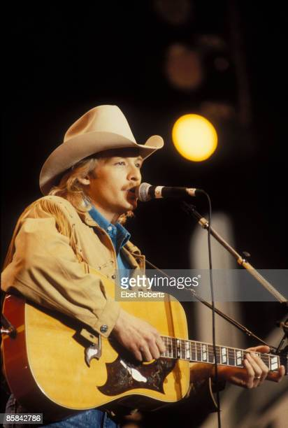 Photo of Alan JACKSON; Alan Jackson performing at Farm Aid in Indianapolis, Indiana on April 7, 1990