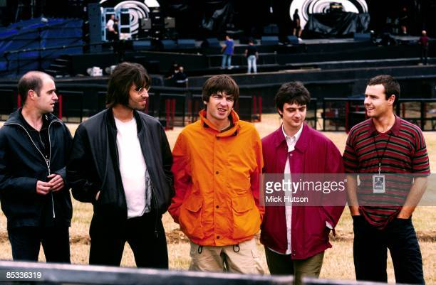 Photo of Alan WHITE and Paul Bonehead ARTHURS and Paul Guigsy McGUIGAN and Liam GALLAGHER and OASIS; Posed group shot backstage L-R Paul 'Bonehead'...