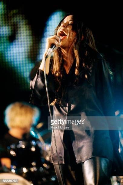 Photo of Alanis MORISSETTE Alanis Morissette performing on stage