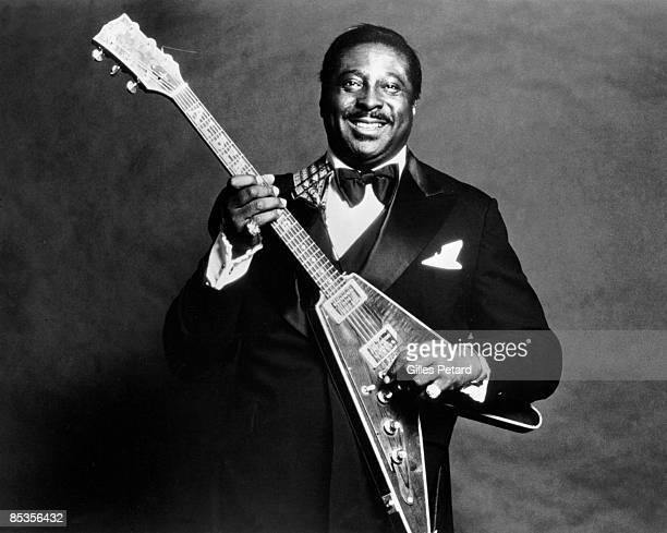 Photo of Albert KING Posed studio portrait of Albert King with Gibson Flying V guitar
