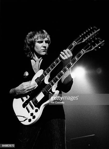 Photo of Alex LIFESON and RUSH Alex Lifeson performing live onstage playing Gibson ES1275 double neck guitar on Permanent Waves tour