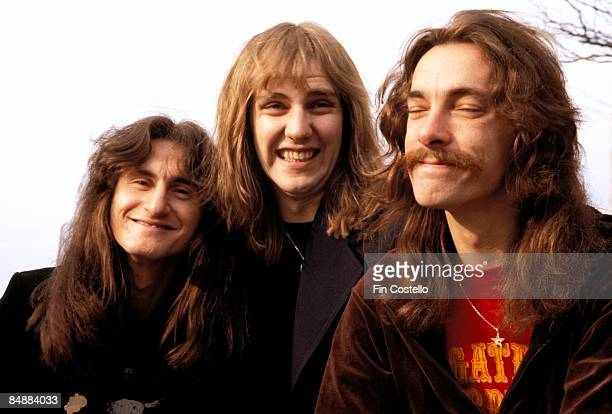 Photo of Alex LIFESON and RUSH and Geddy LEE and Neil PEART LR Geddy Lee Alex Lifeson Neil Peart posed group shot
