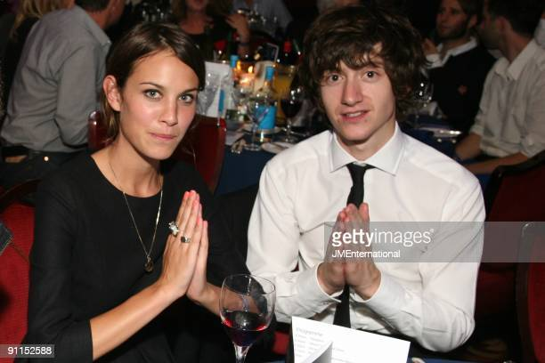 AWARDS Photo of Alexa CHUNG and Alex TURNER and LAST SHADOW PUPPETS Alexa Chung and Alex Turner sitting at a table