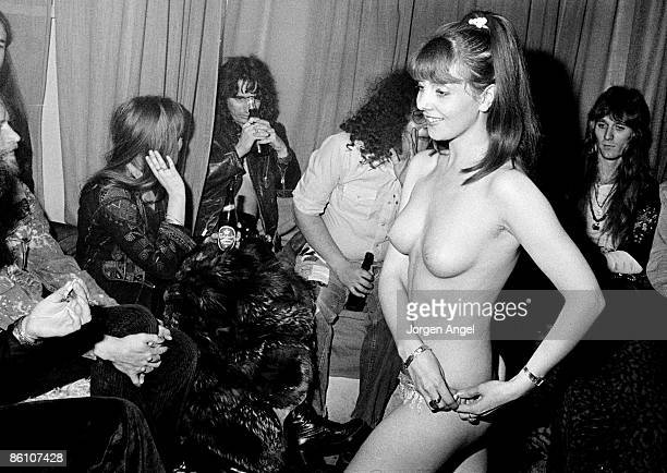 Photo of Alice COOPER Alice Cooper his band and Flo Eddie at a live show in Copenhagen Nov 1972 Alice is trying to hide behind a beer bottle