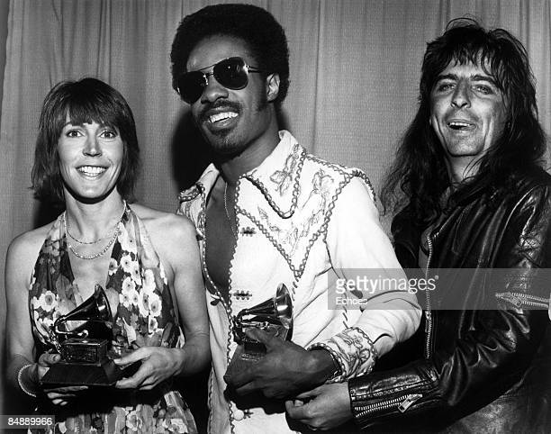Photo of Alice COOPER and Helen REDDY and Stevie WONDER; B&W Posed, L-R Helen Reddy, Stevie Wonder, Alice Cooper back stage at the George Gershwin...