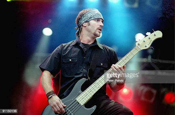 FESTIVAL Photo of ALTER BRIDGE Alter Bridge Pinkpop Landgraaf Nederland 04 juni 2006 Pop grunge rock de bassist draagt een hoofddoek en plukt de bas...