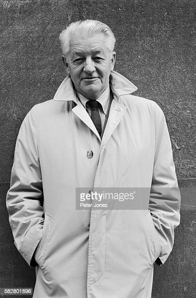 Photo of American author Wallace Stegner . This waist-up photo shows Stegner slightly smiling with his hands in his pocket. Undated photograph.