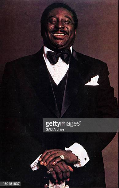 Photo of American blues guitarist and singer Albert King posed wearing bow tie and suit circa 1970