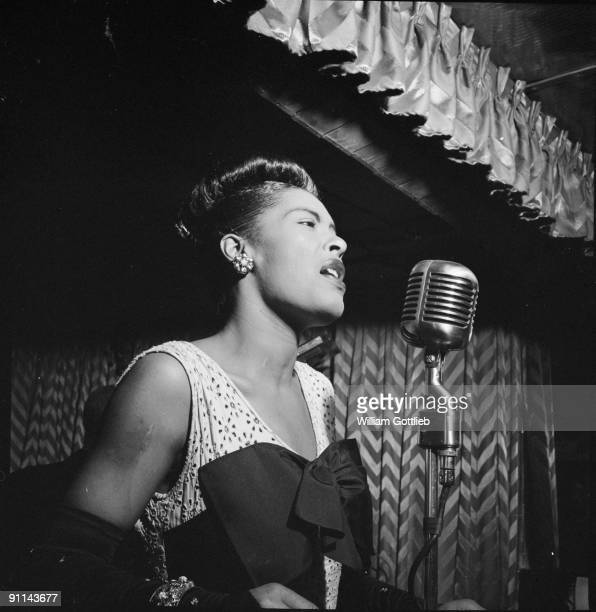 Photo of American jazz singer Billie Holiday performing at the Club Downbeat in Manhattan