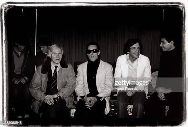 Photo of American Pop artist Andy Warhol fashion designer Halston nightclub owner Steve Rubell and an unidentified man as they sit backstage at...
