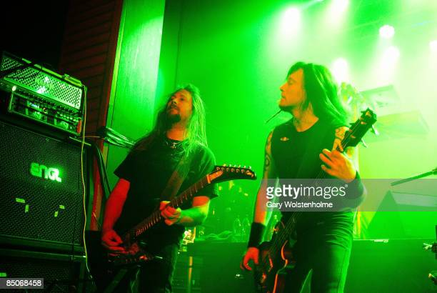 ACADEMY Photo of AMON AMARTH Johan Soderberg and Olavi Mikkonen performing live on stage