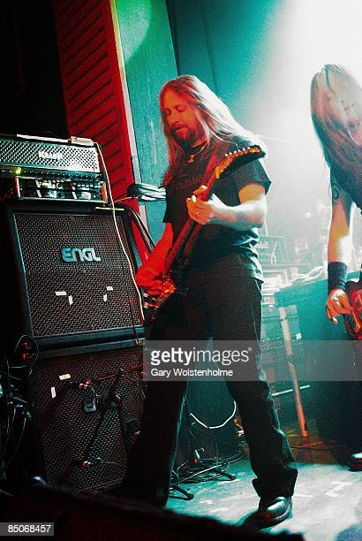 ACADEMY Photo of AMON AMARTH Johan Soderberg performing live on stage