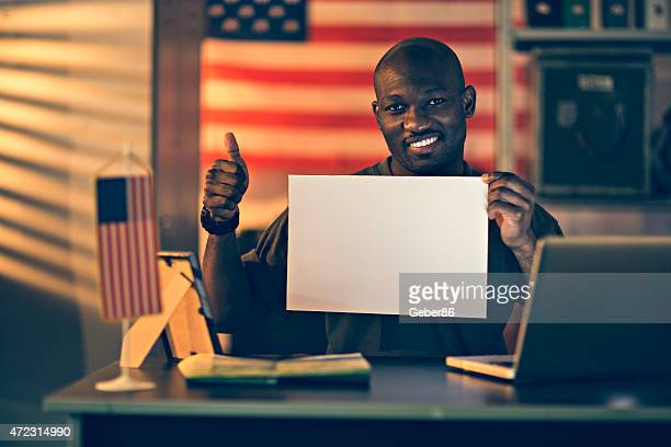 photo of an american soldier holding a sign - person holding blank sign stock pictures, royalty-free photos & images